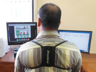 Wearing Posture Medic at his desk.